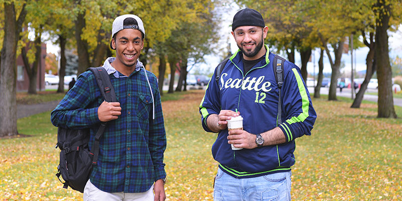 Two students smiling in the fall st SFCC.